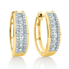 Huggie Earrings With 1/2 Carat TW of Diamonds in 10ct Yellow Gold