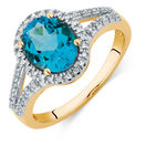 Ring with a Blue Topaz & Diamonds in 10ct Yellow Gold