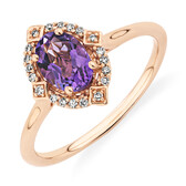 Halo Ring with 0.70 Carat TW of Diamonds and Amethyst in 10ct Rose Gold
