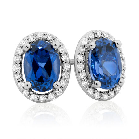 Stud Earrings with Created Sapphire & 0.16 Carat TW of Diamonds in 10ct White Gold