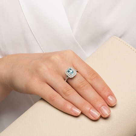 Ring with Blue Topaz & 1/2 Carat TW of Diamonds in 10ct White Gold