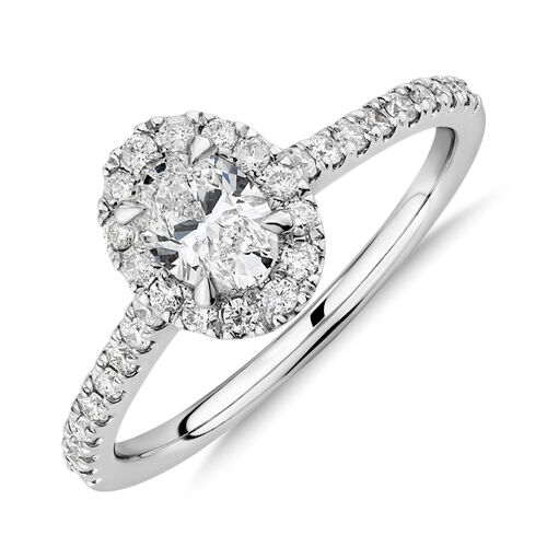 Halo Oval Engagement Ring with 0.92 Carat TW of Diamonds in 14ct White Gold