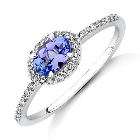Halo Ring with Tanzanite & 0.15 TW Carat Of Diamonds in 10ct White Gold