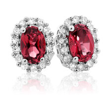 Stud Earrings with Created Ruby & 0.19 Carat TW of Diamonds in 10ct White Gold