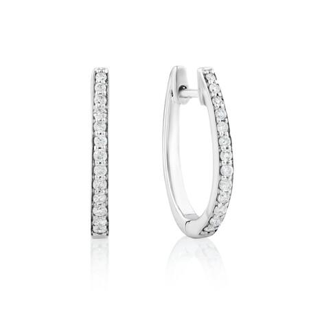 Huggie Earrings With 0.25 Carat TW of Diamonds In Sterling Silver