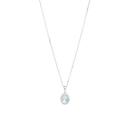Halo Pendant with Aquamarine and 0.04 Carat TW of Diamonds in Sterling Silver