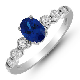 Ring with Created Sapphire & 0.14 Carat TW of Diamonds in 10ct White Gold