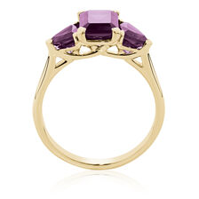 Ring with Created Red Sapphires in 10ct Yellow Gold