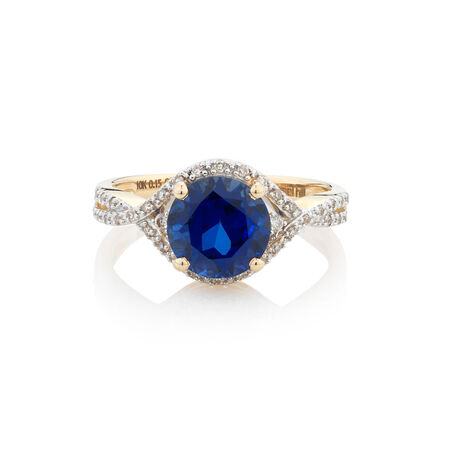 Online Exclusive - Ring with 0.15 Carat TW of Diamonds & Created Blue Sapphire in 10ct Yellow Gold
